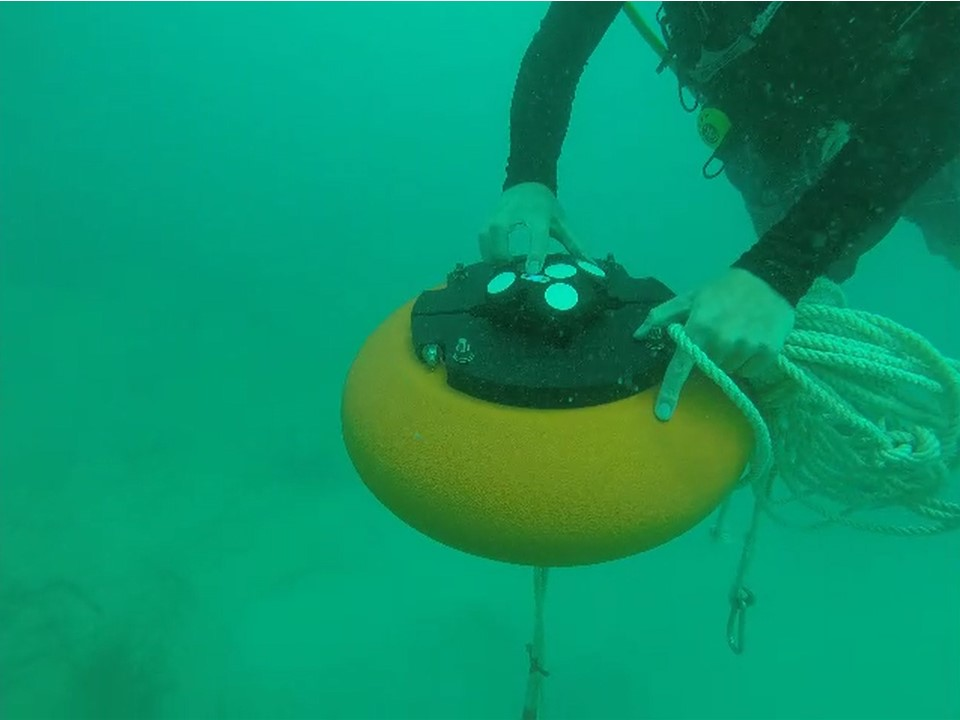 Elliptical Buoy with Nortek ADCP Underwater with Diver