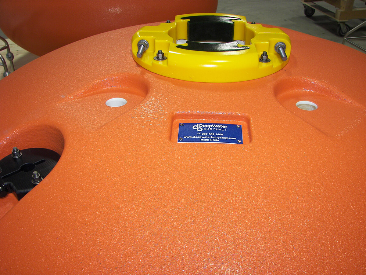 DeepWater Buoyancy spherical ADCP buoy close-up with clamp for Nortek instruments